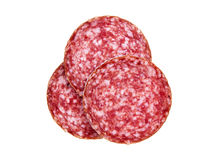 Slices of salami, isolated on a white background. Several slices of salami sausage. Sausage on a white background royalty free stock photography