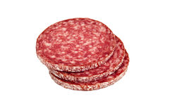 Slices of salami, isolated on a white background. Several slices of salami sausage. Sausage on a white background stock photos