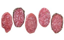 Slices of salami isolated on white Stock Photography