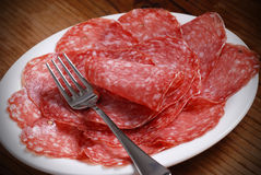 Slices of salami. Italian salami slices on the plate stock photo