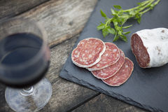 Slices of salami on natural wooden Royalty Free Stock Image