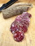 Slices of salami with pepper Royalty Free Stock Photos