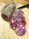 Slices of salami with pepper Royalty Free Stock Images