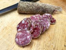 Slices of salami with pepper Stock Photography