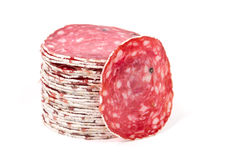 Slices of salami sausage on a white background Stock Photo
