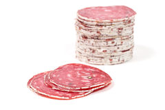 Slices of salami sausage on a white background Royalty Free Stock Image