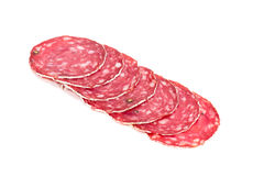 Slices of salami sausage on a white background Royalty Free Stock Photo