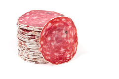 Slices of salami sausage on a white background Royalty Free Stock Photography