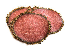 Slices of salami with spices Royalty Free Stock Photos