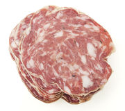Slices of salami  on a white background Stock Image