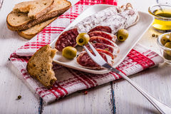 Slices of salami on a white plate Royalty Free Stock Images