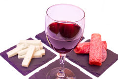 Slices of salami and wine on visa slate dishes from very close Stock Photo