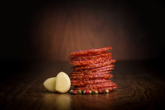 Slices of salami  on a wooden table Royalty Free Stock Photo