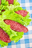Slices of salami wrapped in lettuce Royalty Free Stock Photography