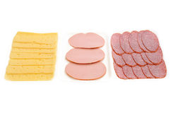 Slices of salami, wurst and cheese Stock Images