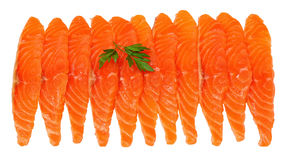 Slices of salmon fillet isolated on white. Delicious fresh slices of salmon fish fillet with isolated on white background with parsley leaf, close-up Stock Images