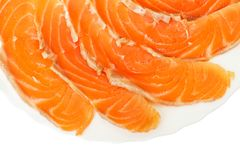 Slices of salmon on a white plate Royalty Free Stock Photos