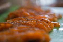 Slices of salted salmon fillet. On a kitchen table Royalty Free Stock Images