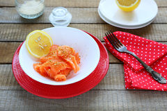 Slices salty salmon fillet and lemon Royalty Free Stock Photography