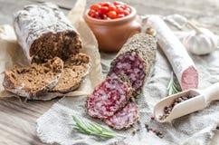 Slices of saucisson and spanish salami Stock Image