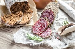 Slices of saucisson and spanish salami on the sackcloth Stock Images