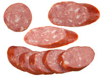 Slices of sausage. Cut slices of sausage on white background royalty free stock photos