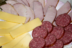 Slices of sausage, ham and cheese Royalty Free Stock Image