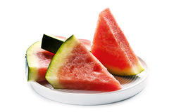 Slices of Seedless Watermelon over White. Seedless watermelon slices on a plate, isolated on white background Royalty Free Stock Photos