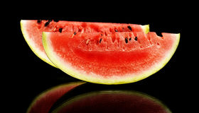Slices and slice watermelon isolated black Royalty Free Stock Image