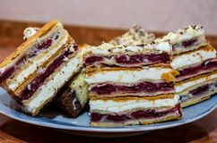 Slices of sliced cake on a plate close-up stock photos