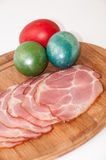 Slices of smoked ham with easter egg Royalty Free Stock Photos
