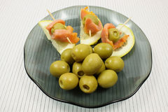 Slices of a smoked humpback salmon with olives and a lemon Royalty Free Stock Image