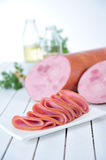 Slices of smoked sausage Stock Photos