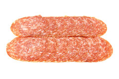 Slices of Smoked Sausage isolated Stock Photos