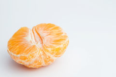 Slices. Some slices of clementine on a white background Stock Images