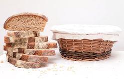 Slices of sourdough bread and a basket Stock Images