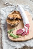 Slices of spanish salami on the sackcloth Royalty Free Stock Images