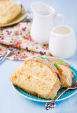 Slices of sponge cake with buttercream on plate. Served for tea, selective focus royalty free stock photos