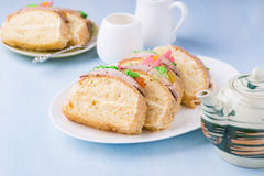 Slices of sponge cake with buttercream on plate Royalty Free Stock Photo
