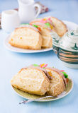 Slices of sponge cake with buttercream on plate Royalty Free Stock Photography