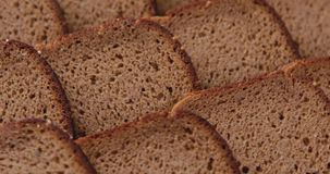Slices of stacked brown bread. stock video footage