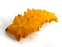 Slices of starfruit. Isolated on a white background stock photos