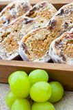 Slices of stollen cake with fresh green grapes Royalty Free Stock Photo