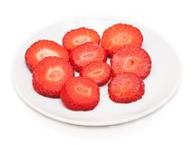 Slices strawberries on the plate,  on white Stock Photography