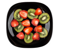 Slices of strawberry and kiwi in plate isolated on white Stock Photo