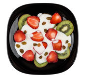 Slices of strawberry and kiwi with yogurt in plate Stock Images