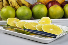 Slices of sweet lime and a knife in a tray Stock Image