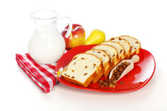 Slices of sweet loaf with raisins and milk Royalty Free Stock Photos