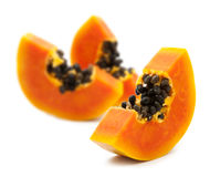 Slices of sweet papaya. On white background Royalty Free Stock Images