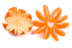 Slices of tangerine disclosed in the form a flower isolated on white background Royalty Free Stock Photography